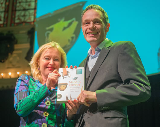 Pieter Steinz receives the first copy of Made in Europe from the hands of Jet Bussemaker, Dutch Minister of Education, Culture and Science. Photo: Victor Schiferli